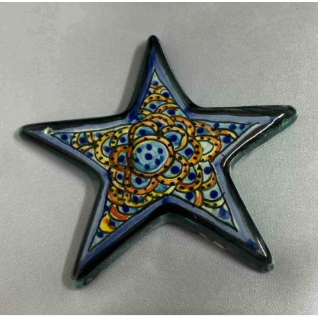 Small ceramic star to hang